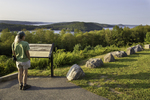 A woman looks out at the Quabbin Reservoir from the Enfield Lookout