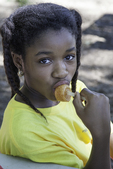 Young girl eating a popsicle