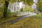 Sidewalk, house, and autumn leaves in Old Deerfield Village, Deerfield, MA