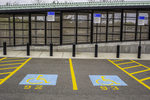 Two handicapped parking spaces at an MBTA station