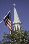 American flag with the Congregational Church bell tower in the background, Concord, MA