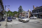 Cars traveling on Main Street in Concord, MA