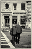 Black and white - two people crossing Beacon Street in Boston, MA