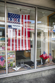 Flag hanging in a store window