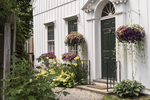 Flowers hanging by the door of a home in Stockbridge, MA