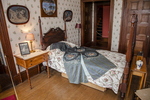 A bedroom at Naumkeag with clothing draped over the bed