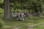 A group of visitors to Naumkeag listen to the garden docent under the tall Swamp White Oak tree.