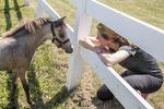 Woman enjoying her miniature horse