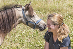 Miniature horse gives her owner a kiss