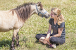 Horse gives her owner a sniff