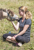 Woman and her miniature horse