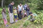 Workshop leader teaching children about the natural world