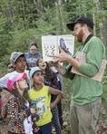 Workshop leader teaching children about birds