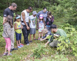 Workshop leader teaching children about the natural world