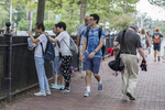 Tourists taking photographs in Harvard Square, Cambridge, MA