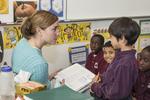 Teacher helping a student