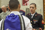 High school students at a college fair talking with a U.S. Marine recruiter. #11