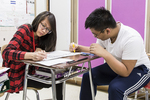 Two students working together in the classroom