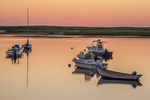Boats moored in Pamet Harbor, Truro, MA at sunset