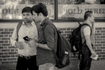 Three students in Harvard Square, Cambridge, MA
