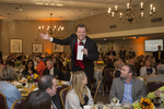 Auctioneer working the crowd at Pleasant Valley Country Club