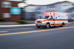Ambulance racing down Highland Street in Worcester, MA on its way to the hospital