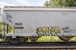 Boxcar with graffiti painted on the side
