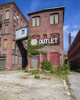 Abandoned buildings that once housed thriving manufacturing businesses