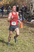 Runner approaching the finish line in a cross country fall race