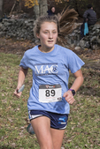 Young woman finishing a cross country race