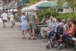 People sitting along the wharf in Camden, Maine