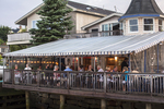 People dining on the wharf in Camden, Maine