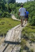 A couple walking along the boardwalk in Newburyport, MA