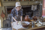 Old Sturbridge Village interpreter cooking as they did in the 1830's