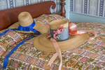 Hats on a bed at Old Sturbridge Village