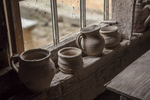 Pottery in the window at Old Sturbridge Village, Sturbridge, MA