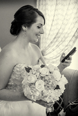 Bride checking her phone before the wedding
