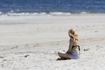 Woman sitting on Crane Beach