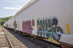 Boxcars at a railroad station in Stockbridge, MA with graffiti painted on the side