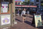 Woman walking through Harvard Square