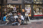 Students eating at an outdoor café in Harvard Square