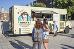 People buying lunch at a food truck in Harvard Square