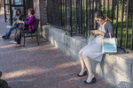 Woman on her cell phone in Harvard Square