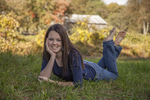 Teenage girl in a farm meadow