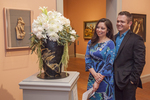 A handsome couple looking at a floral display at the Worcester Art Museum