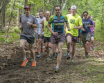Men and women participating in a trail run race in Wendell, Massachusetts