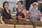Volunteers packing vegetables in boxes for shipment to a food pantry