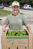 Woman with a box of peppers ready to be sent to a food pantry