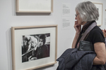 Woman looking at a black and white photograph in a gallery