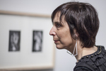 Woman intently looking at art work in a gallery
